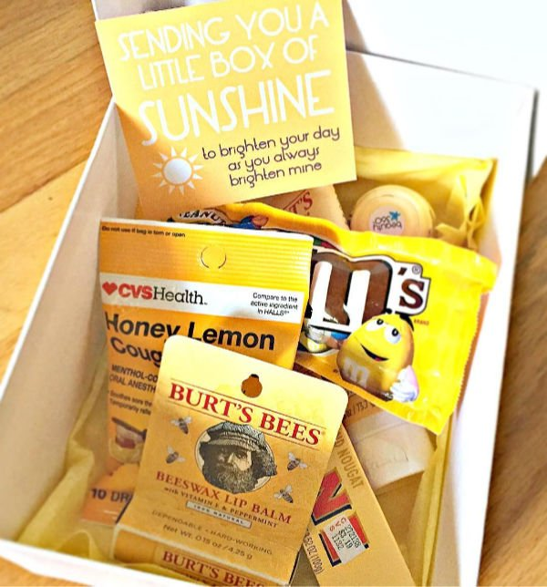 a gift box with a cute note and various yellow items