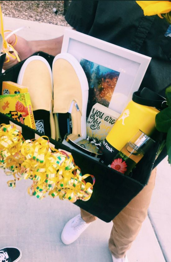 birthday gift box with yellow vans being held by someone