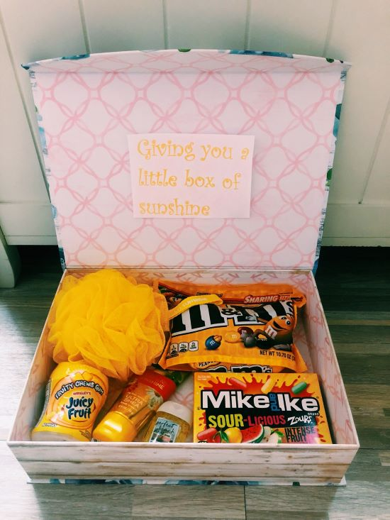 """a box of gifts that reads """"giving you a little box of sunshine"""""""