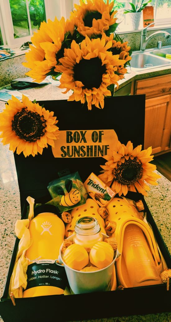 care package idea with yellow crocks, lip balm, sunflowers