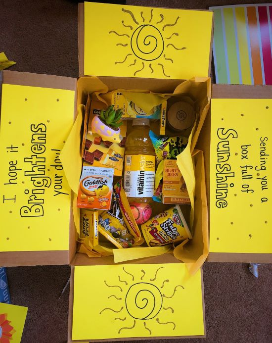 care package filled with bright yellow items