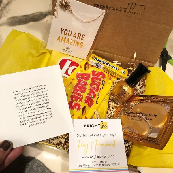 a bright box with under eye masks, sugar babies, and a nice note