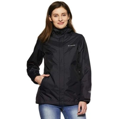female college student smiling and wearing a Columbia waterproof jacket