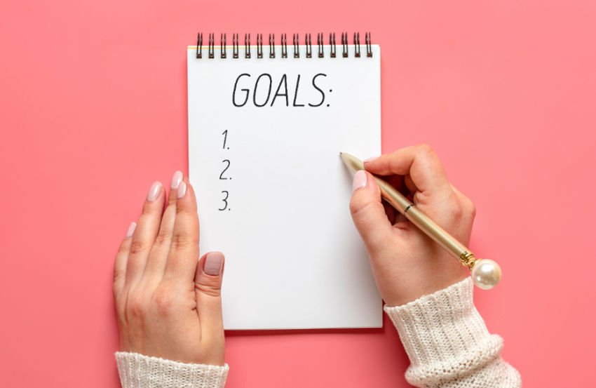 notebook paper with goals on pink background