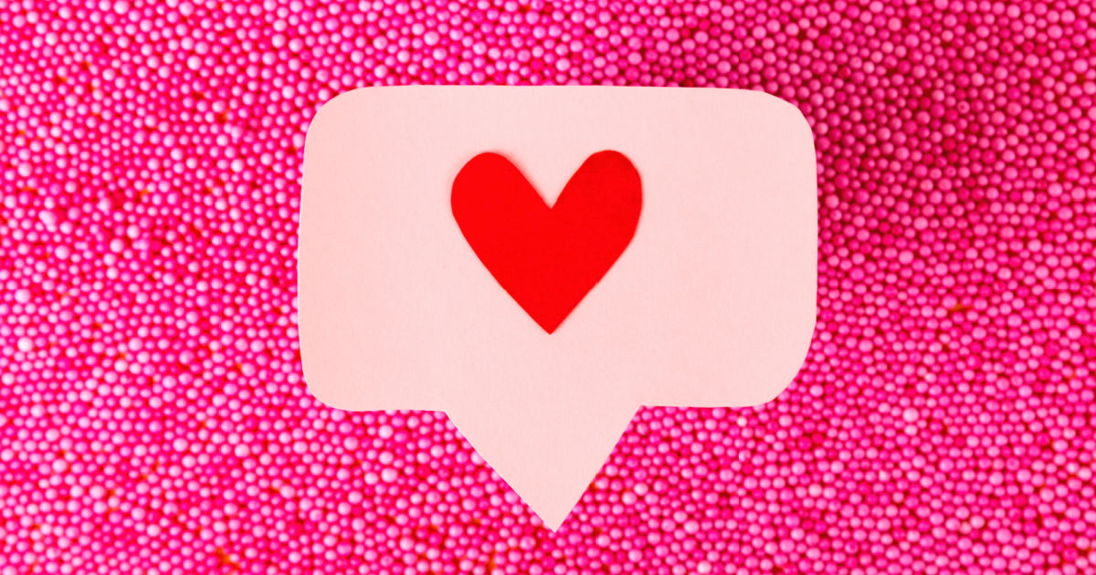 hot pink bead background with heart message icon