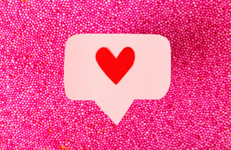 notification heart icon on pink textured background