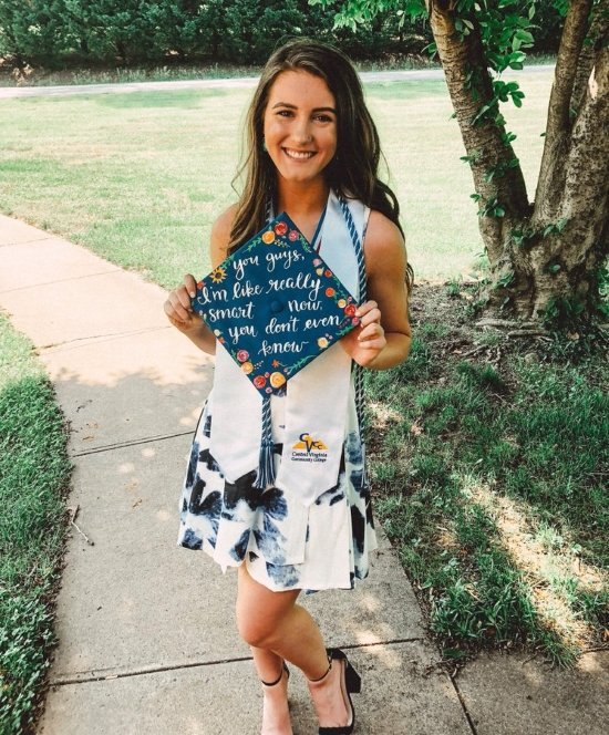 college girl holding the office quote graduation cap