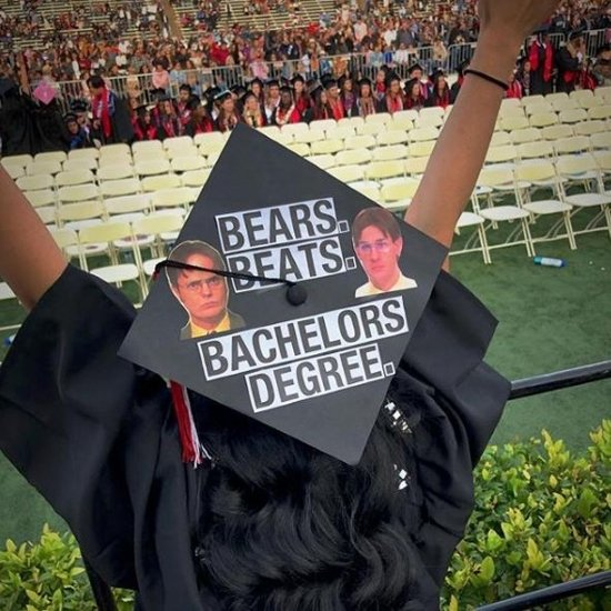 excited graduate wearing a Dwight, the Office grad cap