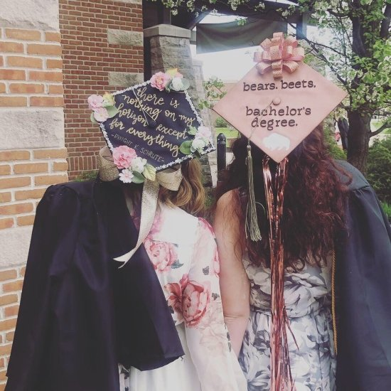 two college girls wearing grad caps with quotes from the office