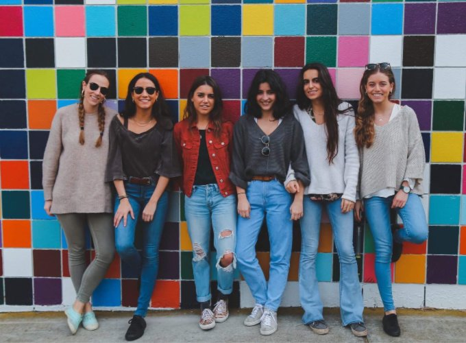 group of women with colorful background