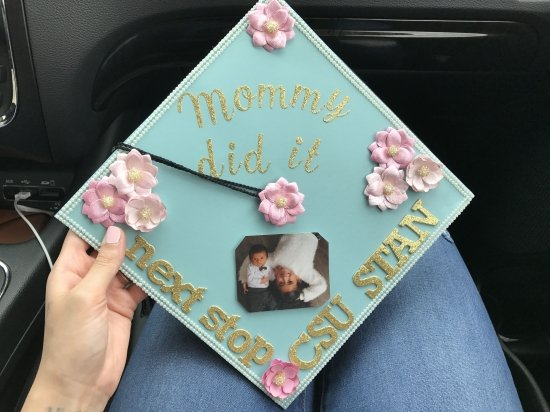 """turquoise graduation cap that reads """"mommy did it next step csu stan"""""""