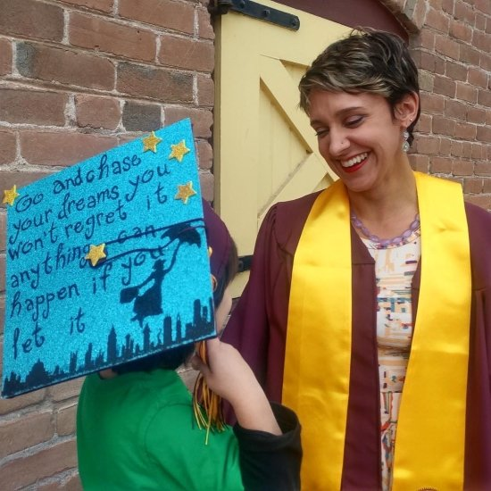 smiling mom college graduate and child with cap