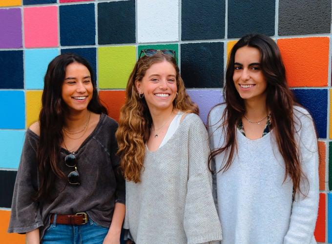 happy female graduate students
