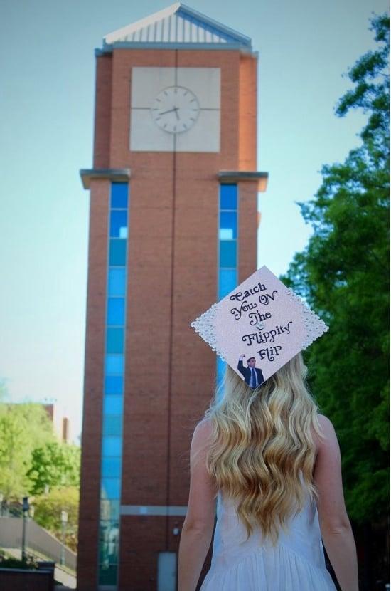 college girl facing away wearing pink graduation cap