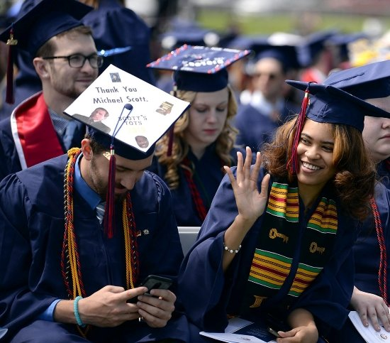 college graduates with the office grad cap