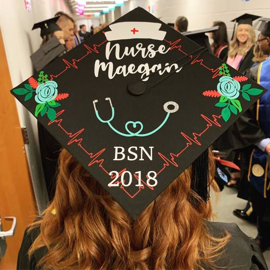 grad cap decorated with flowers, nurse stickers, and words