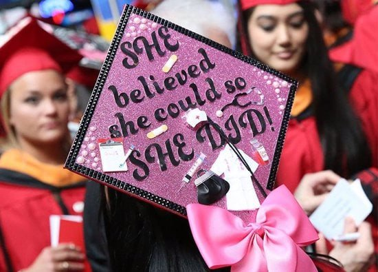 """pink sparkle grad cap with quote that says, """"she believed she could so she did"""""""