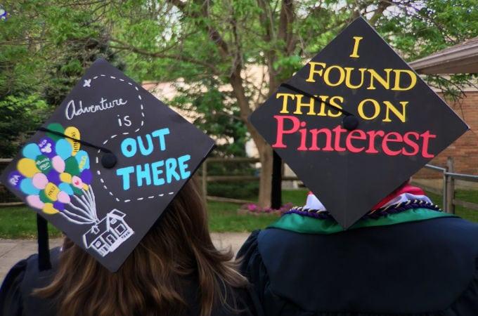 graduates wearing decorated grad caps