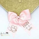 light pink BSN nurse custom graduation cap bow