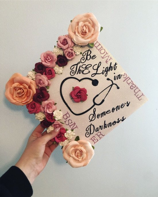 """pink glitter graduation cap decorating with nurse quote, """"be the light in someone's darkness"""" BSN ER"""
