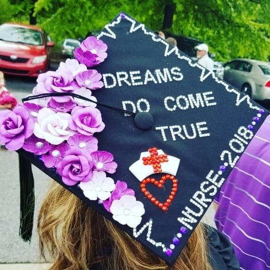 "nurse graduation cap that reads, ""dreams do come true"""
