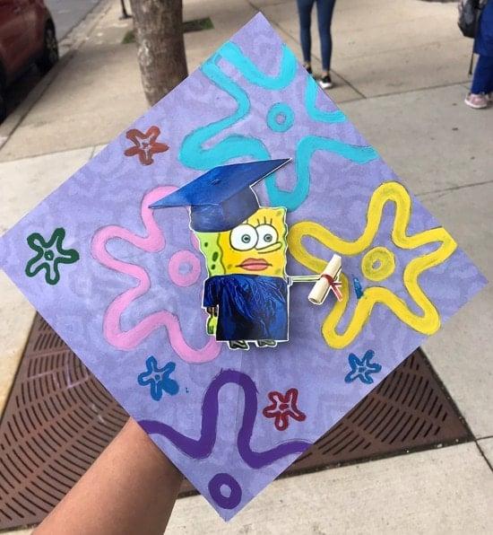 spongebob squarepants holding diploma grad cap design