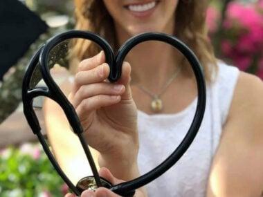 stethoscope shaped into a heart by nurse graduate
