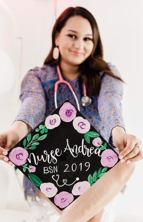 nursing school graduate showing off her painted cap