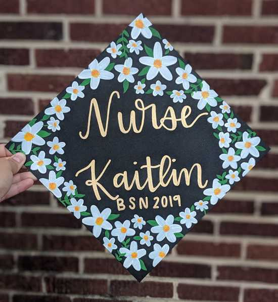 BSN nursing graduation cap topper design with painted white flowers