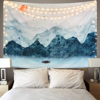 Sevenstars Foggy Watercolor Mountain Tapestry hanging above a dorm room bed