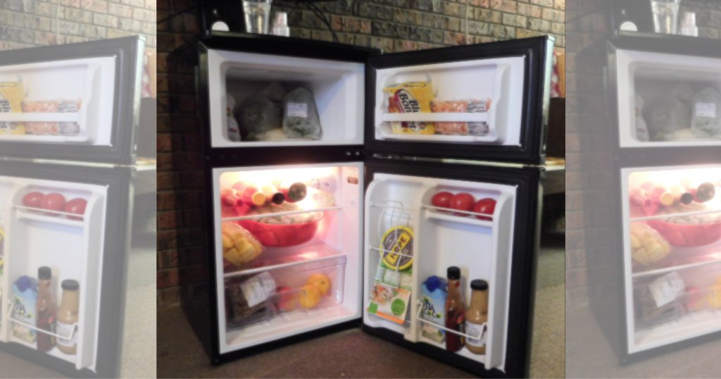 opened mini fridge with freezer showing its stocked with food