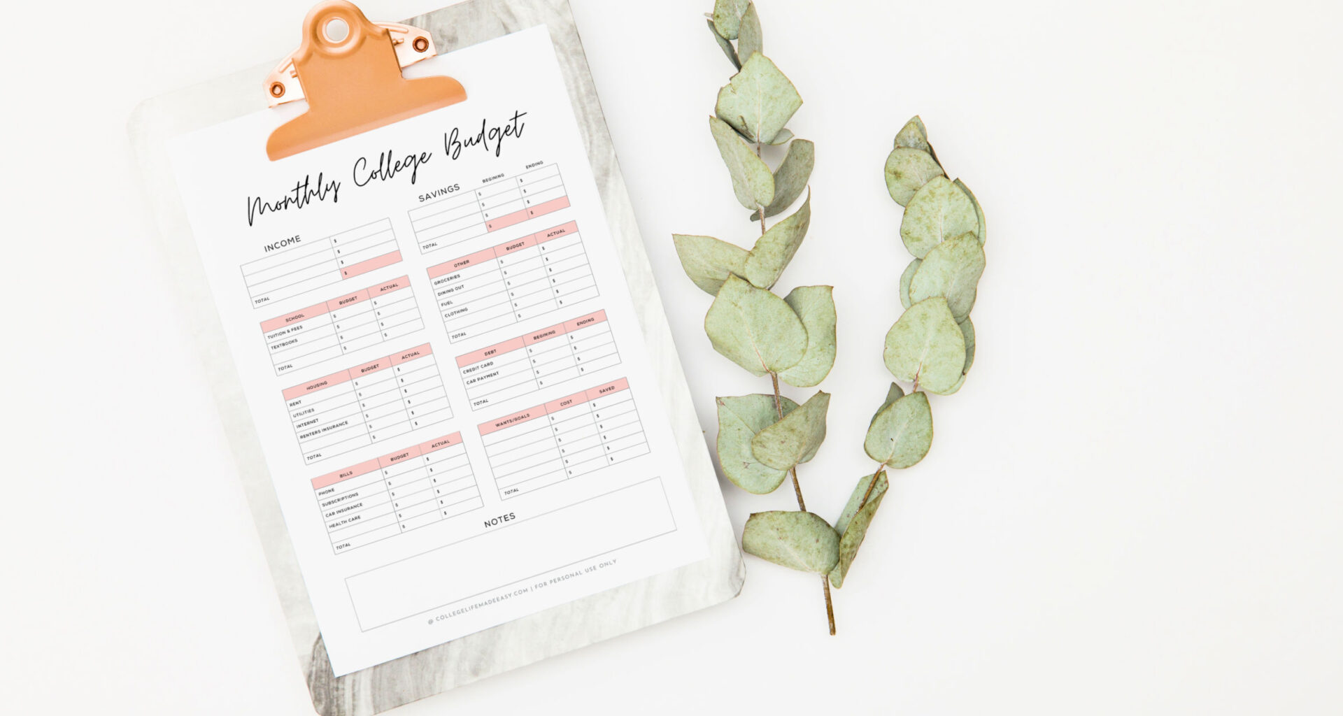 printable monthly college student budget template on a clipboard with leaf branch on the right