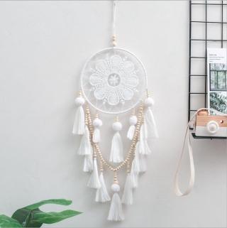 white handmade dream catcher with tassels