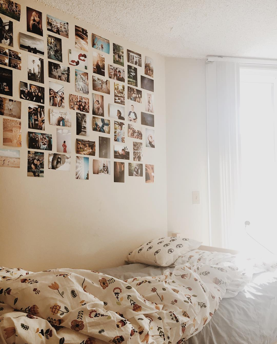 light and bright dorm decorated with pictures on the wall
