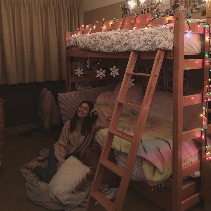 college girl posing next to her bunk bed in the UCLA dorms