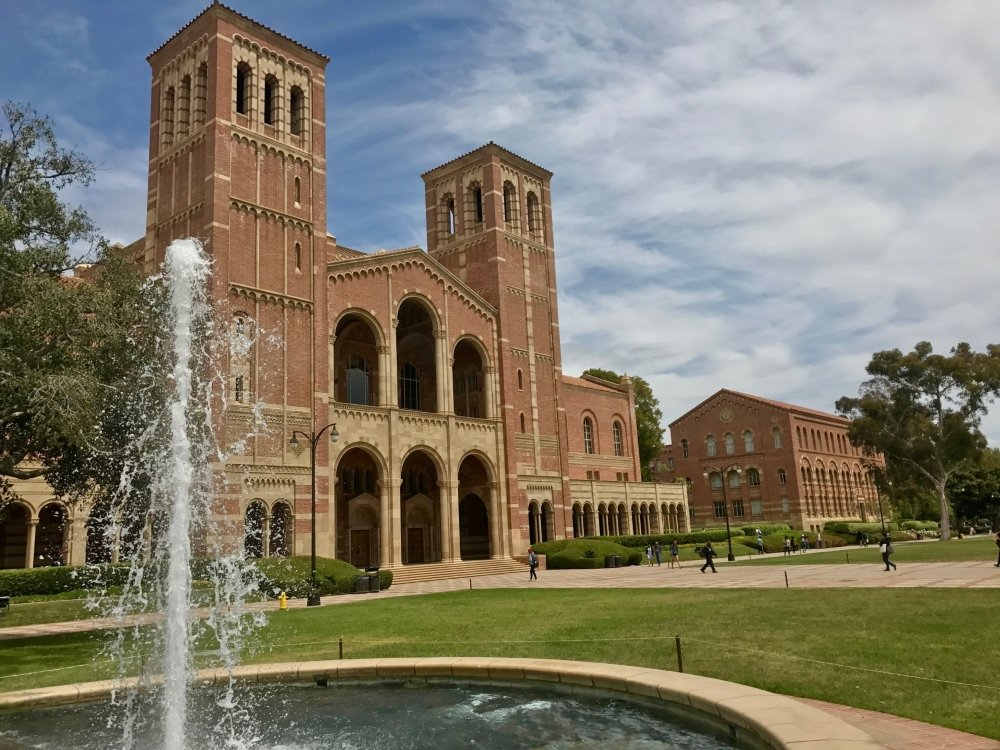 Royce Hall on campus at UCLA with fountain spraying water in front