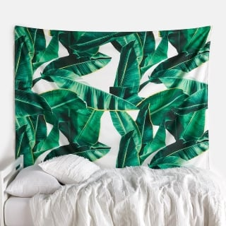 white and green wall tapestry for a dorm