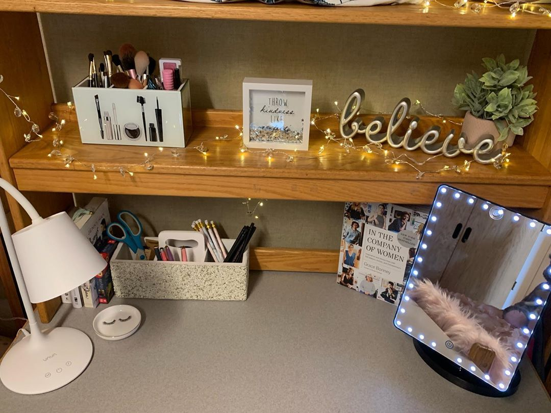 closer look at the decor on the dorm room desk