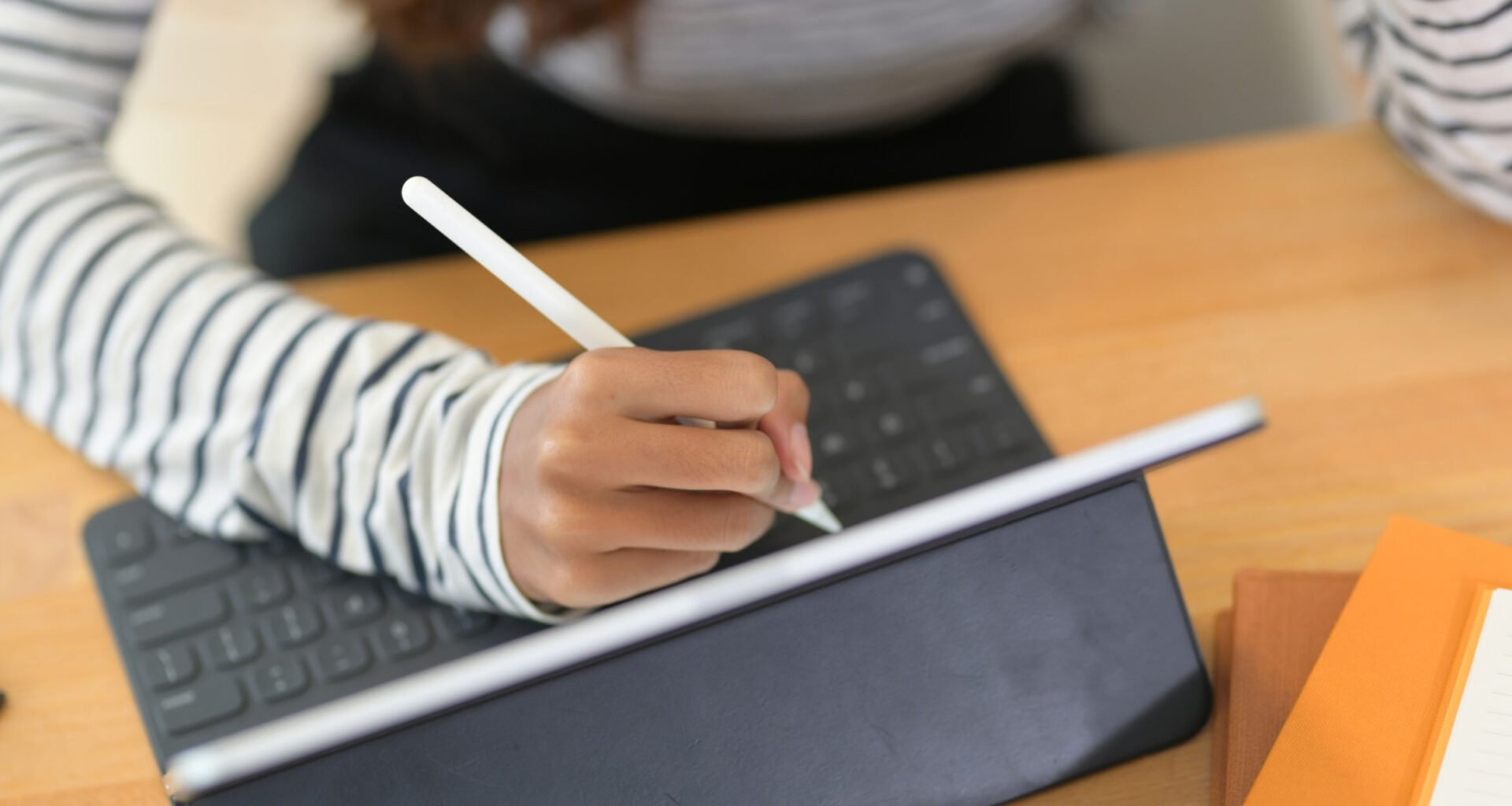college student using stylus for note taking on tablet