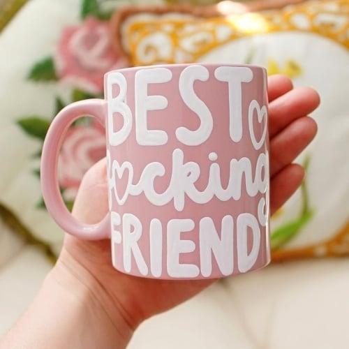 "pink mug with handwritten script that reads ""best fucking friend"" - perfect gift idea for girl best friends"