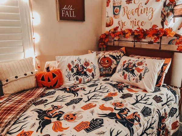 bed with Halloween haunted horseman comforter and throw pillows