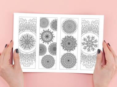 woman's hands framing sheet of printable black and white mandala design bookmarks