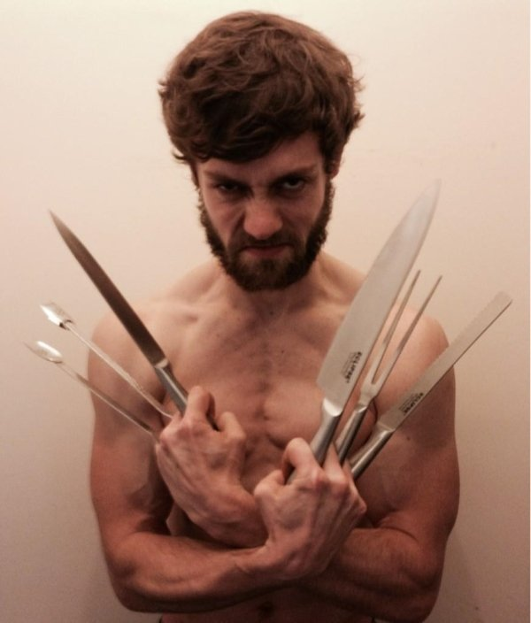 guy holding knives mimicking wolverine from x-men