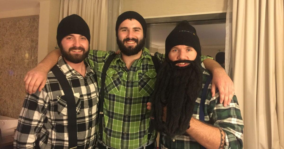 group of bearded men in lumberjack halloween costumes