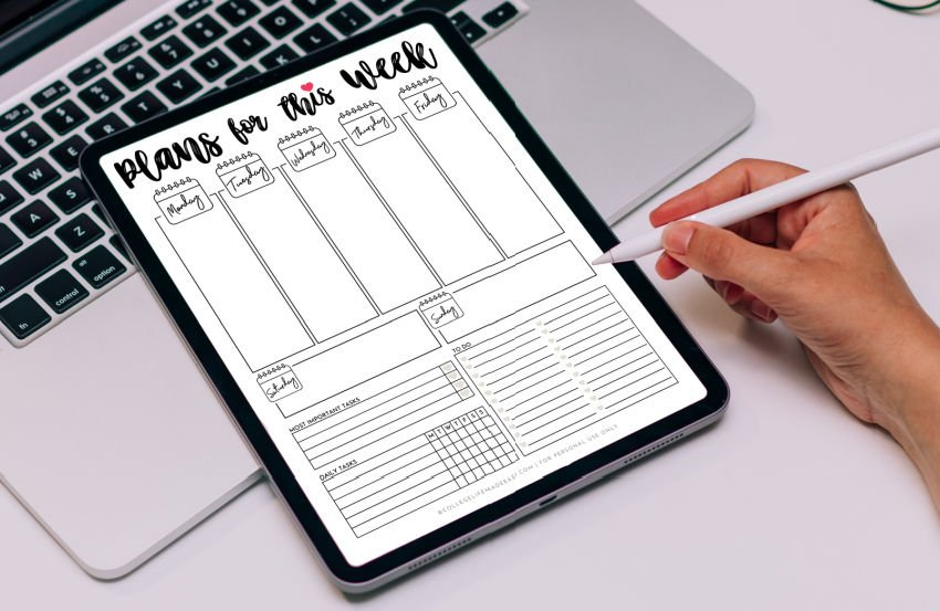 hand using pen with ipad for weekly digital planner template