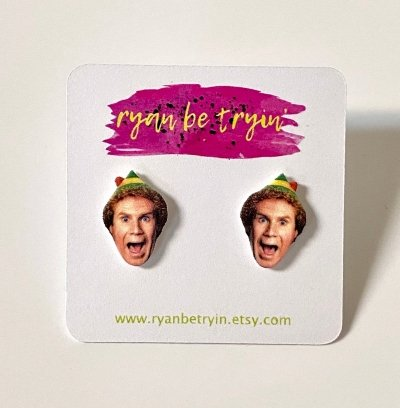the face of an Excited Buddy the Elf as a pair of funny earrings