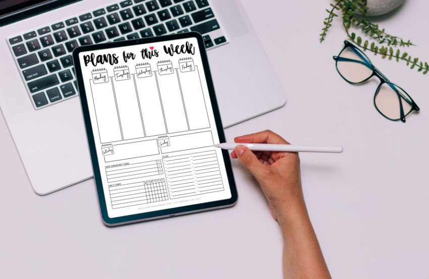 overhead view of the cute weekly planner printable on a digital device