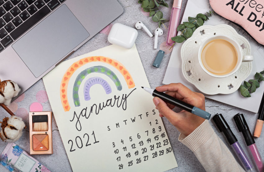 college student using january 2021 rainbow calendar to mark scholarship deadlines