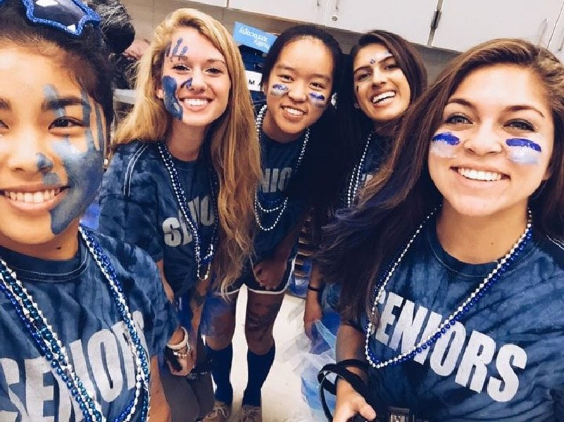 group of high school senior girls dressed for spirit week in blue tie-dye shirts