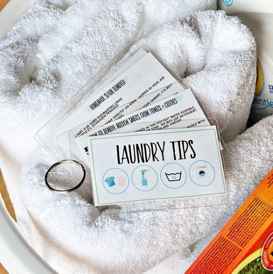 laminated laundry tips held together by a metal ring